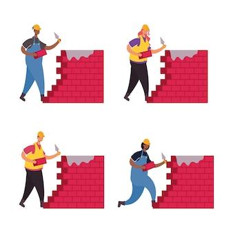 Konstruktorzy robotnicy z postaciami ścian z cegieł