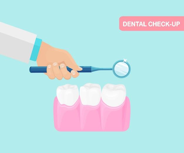 Kontrola zębów. dentysta trzyma instrumenty w rękach badając ząb pacjenta