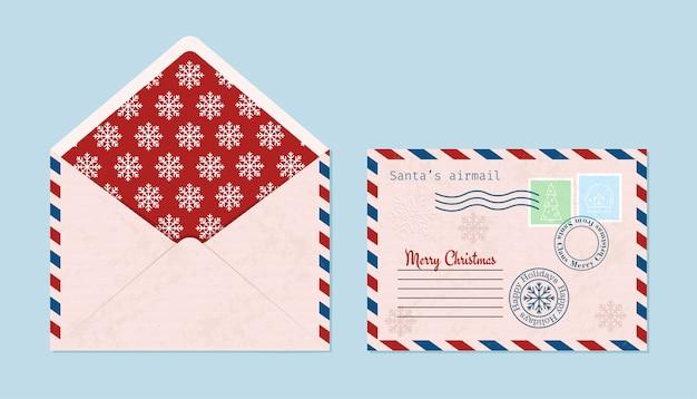 Koperta świąteczna z pieczęciami, znaczkami, otwarta i zamknięta.