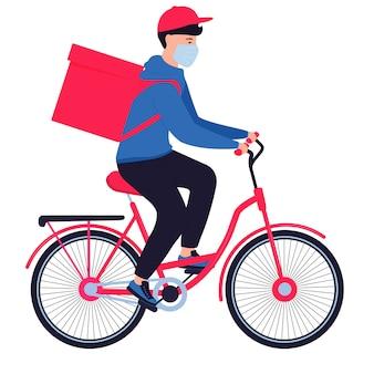 Koronawirus epidemia. doręczeniowy mężczyzna w masce ochronnej niesie jedzenie na rowerze. darmowa dostawa żywności.