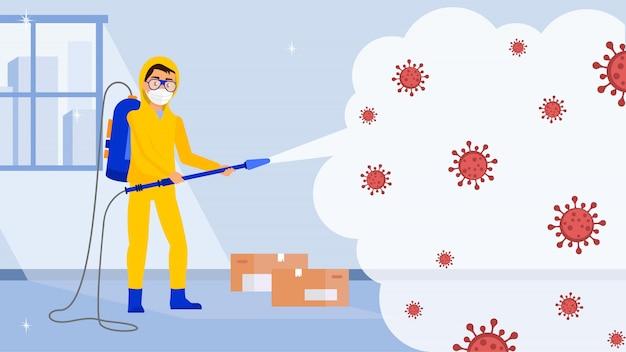 Koronawirus - pracownik w kombinezonie przeciwdeszczowym dezynfekuje pomieszczenie