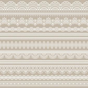Koronkowa bezszwowa granica. białe bawełniane paski koronki, haftowane ozdobne ozdobne oczka, poziomy pasek tekstylny ręcznie robiony wektor zestaw. maswerk w stylu romantycznym na serwetkę lub notatnik