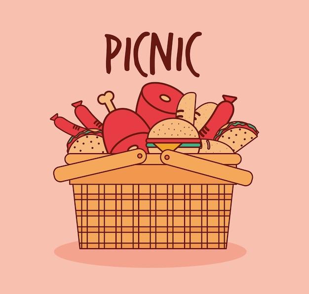 Kosz na piknik z mięsem, burgerami i tacos pod ilustracją z napisem piknikowym