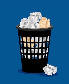 Kosz na śmieci i pogniecione papiery
