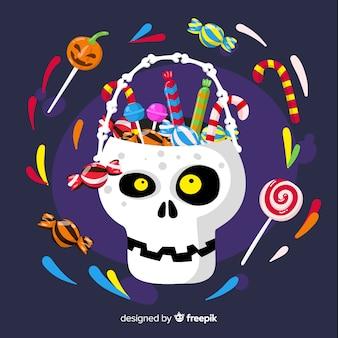 Kosz z czaszką halloween pełen cukierków i słodyczy
