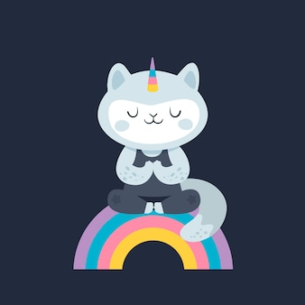 Kot jednorożec. kotek jogi na tęczy. zdrowy tryb życia.
