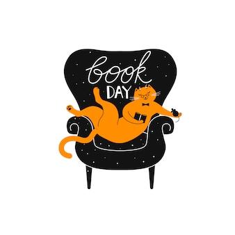 Kot siedzi w fotelu, czytając książkę.