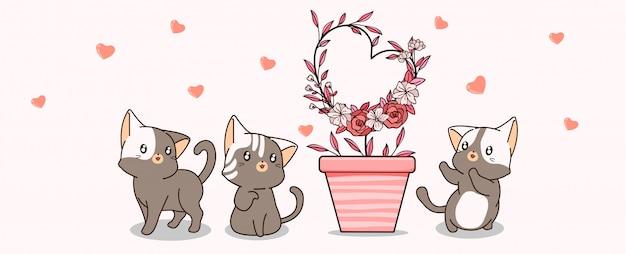 Koty kawaii dbają o roślinę w kształcie serca