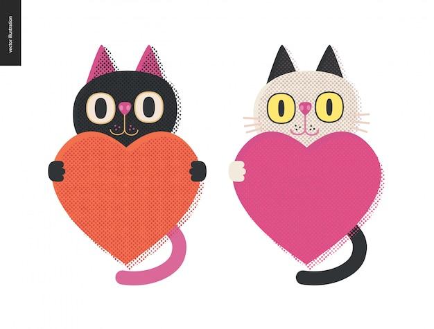 Koty trzymające serce