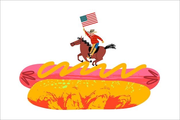 Kowboj na koniu z amerykańską flagą w ręku. duży hot dog.