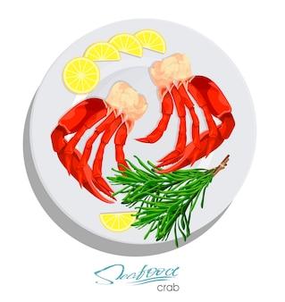 Krab mięsny z rozmarynem i cytryną na talerzu