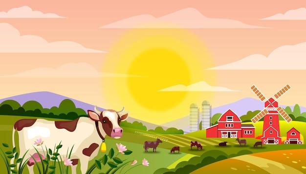 Krajobraz farmy mlecznej z bykiem, zielonymi polami, krowami, dużym wschodzącym słońcem, trawą, młynem