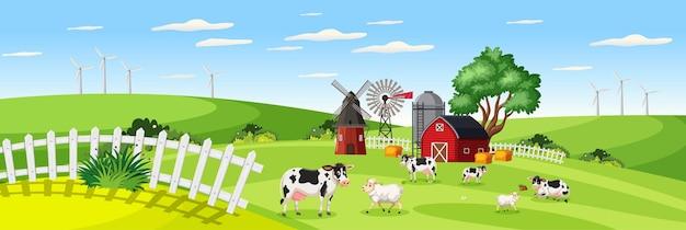 Krajobraz gospodarstwa z farmą zwierząt w polu i czerwonej stodole w sezonie letnim