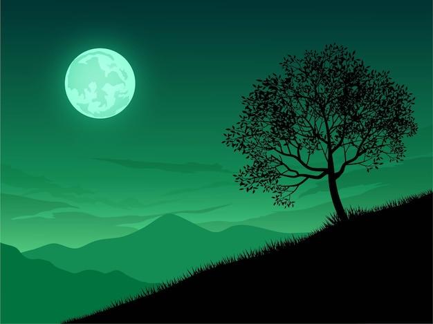 Krajobraz księżyca z sylwetka drzewa