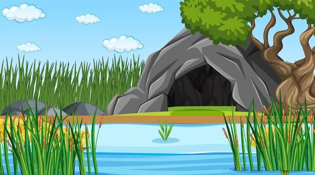 Krajobraz lasu przyrody w scenie dziennej z kamienną jaskinią