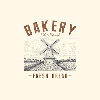 Krajobraz logo wiatraka w stylu vintage, ręcznie rysowane lub grawerowane w stylu retro, może być używany do logo piekarni, pola pszenicy ze starym budynkiem