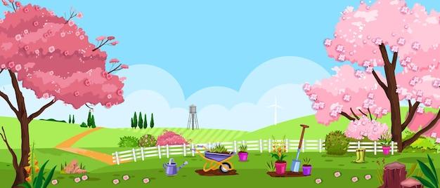 Krajobraz przyrody przydomowego z kwitnącym drzewem sakura, płotem, trawą i łąką.