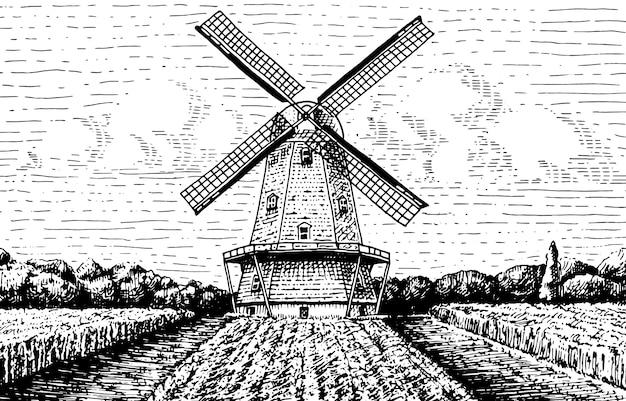 Krajobraz wiatraka w stylu retro, ręcznie rysowane lub grawerowane, może być używany do logo piekarni, pola pszenicy ze starym budynkiem