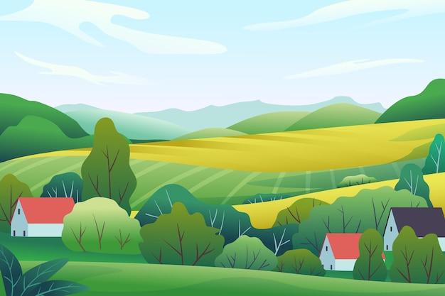Krajobraz wsi z polem i wzgórzami