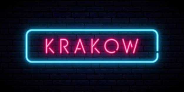 Kraków neon znak na białym tle na czarnej ścianie
