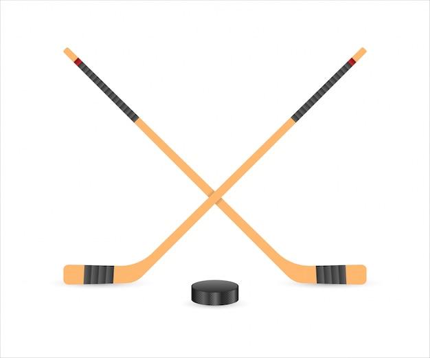 Krążek do hokeja na lodzie i kije.