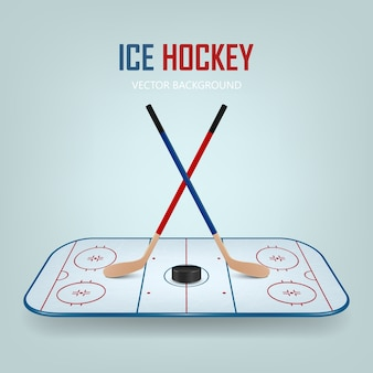 Krążek hokejowy i skrzyżowane kije na tle pola hokejowego.