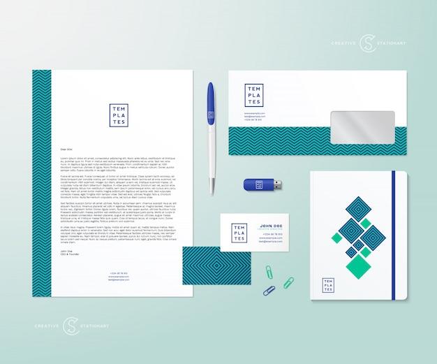 Kreatywna geometria zielony i niebieski realistyczny stacjonarny zestaw z miękkimi cieniami dobry jako szablon lub makieta tożsamości biznesowej.