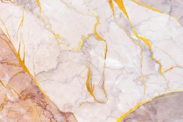 Kreatywne marmurowe tło ze złotymi detalami