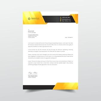 Kreatywny biznesowy papier firmowy pomarańczowy i czarny profesjonalny szablon projektu