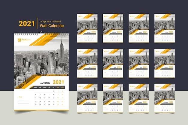 Kreatywny korporacyjny szablon kalendarza ściennego 2021 w kolorze żółtym