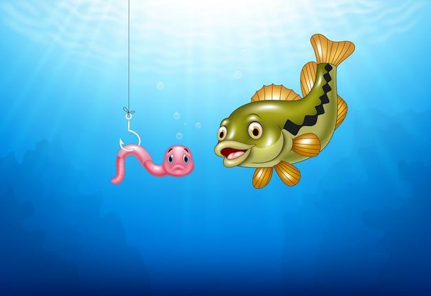 Kreskówka bas ryba poluje różowego dżdżownicy