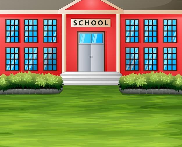 Kreskówka budynek szkoły z zielonym trawnikiem