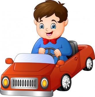 Kreskówka chłopiec jedzie samochód