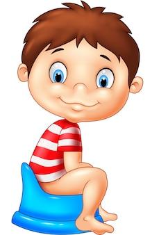 Kreskówka chłopiec siedzi na nocnik