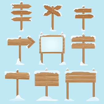 Kreskówka drewniane znaki ze śniegiem.