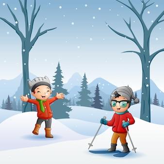 Kreskówka dzieci bawiące się na śniegu