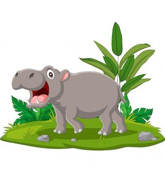 Kreskówka hipopotam z otwartymi ustami w trawie