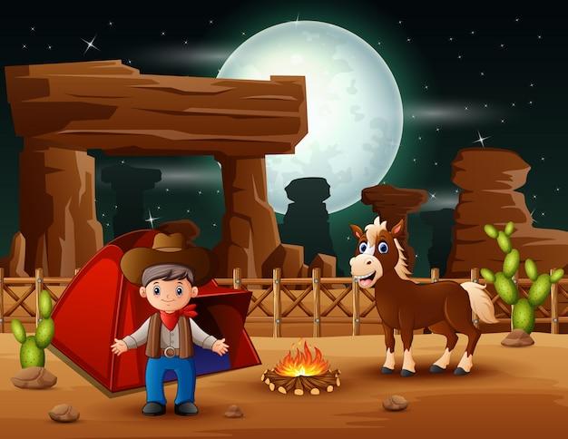Kreskówka kowboj camping z koniem w nocy