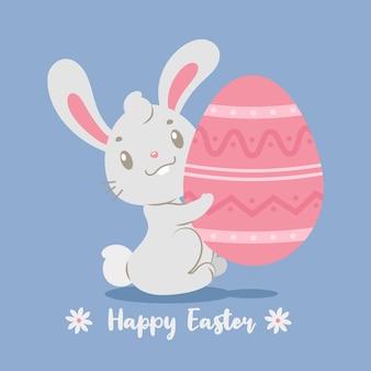 Kreskówka króliczek trzyma gigantyczne malowane jajko wielkanocne