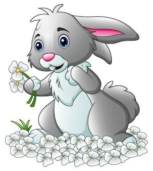 Kreskówka królik z białych kwiatów tłem