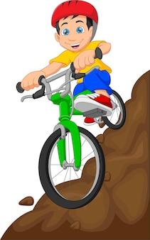 Kreskówka ładny chłopiec kolarstwo górskie na białym