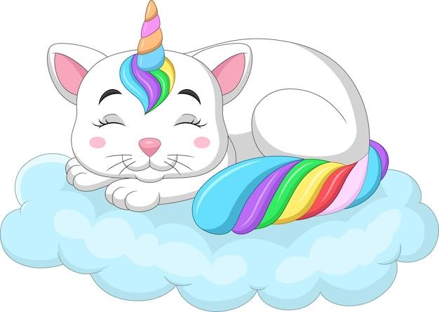 Kreskówka ładny kot jednorożca śpi na tęczowej chmurze