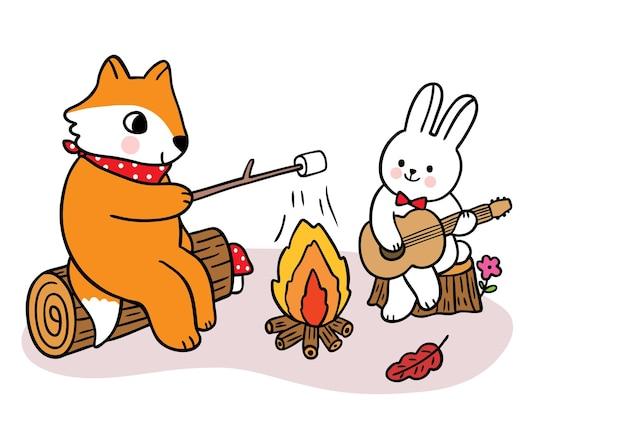 Kreskówka ładny ręcznie rysować lisa i królika na kempingu w jesiennym wektorze