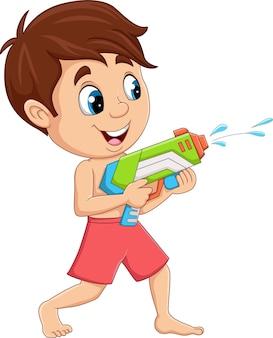 Kreskówka mały chłopiec bawi się pistoletem na wodę