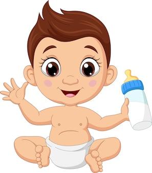 Kreskówka mały chłopiec siedzi z mlekiem w butelce