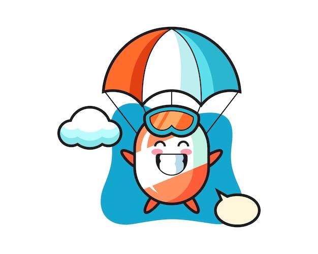 Kreskówka maskotka cukierek skacze ze spadochronem z radosnym gestem