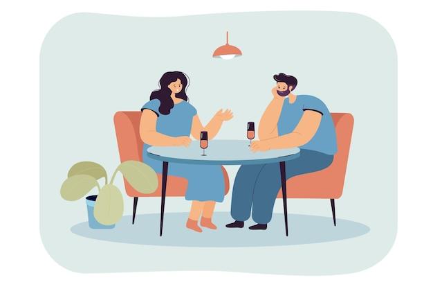 Kreskówka mąż ignorujący żonę siedząc przy stole, pijąc