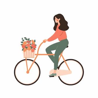 Kreskówka młoda kobieta jeździ rowerem z bukietem w koszu. pojęcie miłości na rowerze.