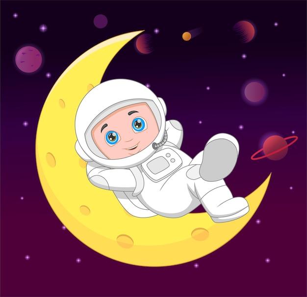Kreskówka młody astronauta na półksiężycu
