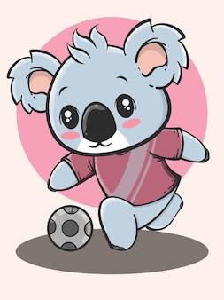 Kreskówka na świeżym powietrzu - koala gra w piłkę nożną